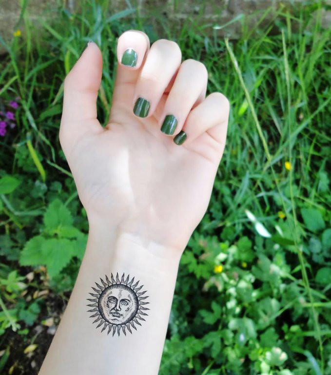 Unterarm Tattoo: Sonne