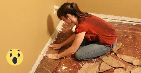Sie beginnt ihren Fußboden mit Papier auszulegen. Die Idee dahinter ist einmalig