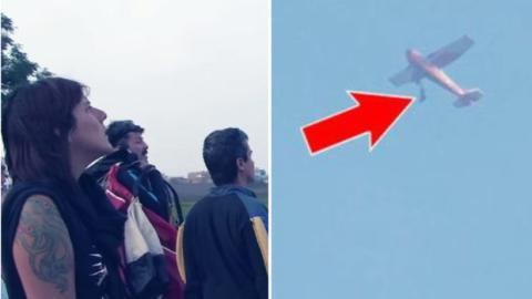 Er will mit dem Fallschirm abspringen ... Bleibt aber am Flugzeug hängen