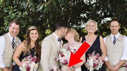 Mit diesem Kuss stiehlt das kleine Mädchen dem Brautpaar die Show