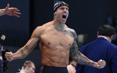 Konkurrenz aus der eigenen Familie: Labrador schwimmt gegen 7-fachen olympischen Goldmedaillengewinner